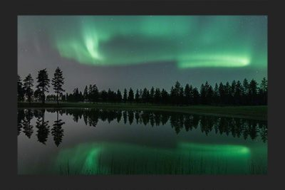 Auroras over a lake in Oulu, Finland