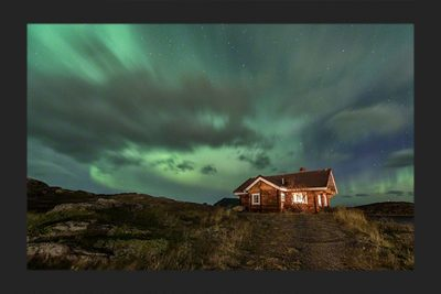Cabin under Northern lights