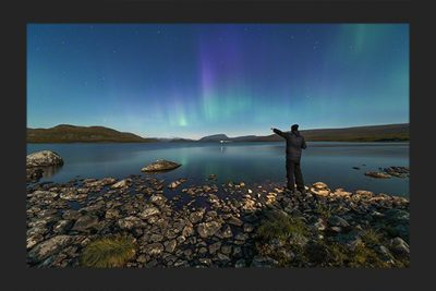 Pointing at the aurora borealis