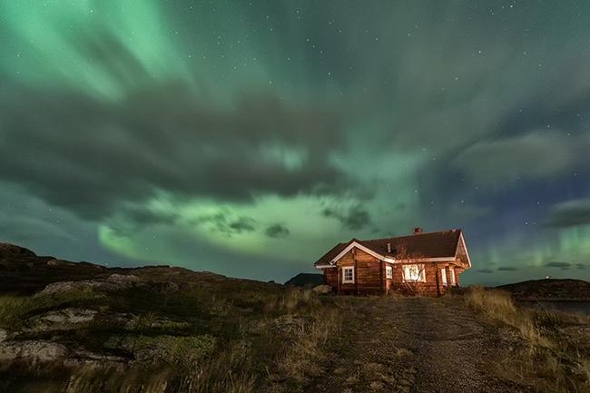 Cabin under Northern lights