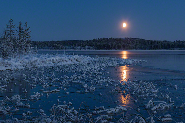 Moonrise above new ice