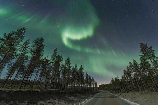 Auroras over a road near Oulu, Finland