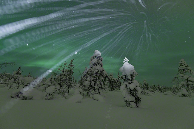 Snowflake trails with northern lights