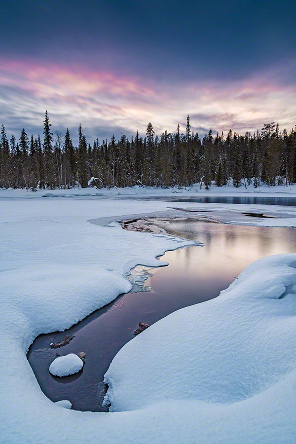 Winter sunset with water