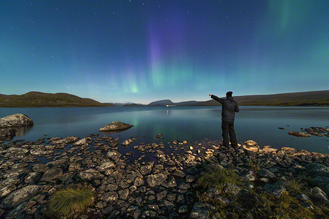 Pointing at the Northern lights
