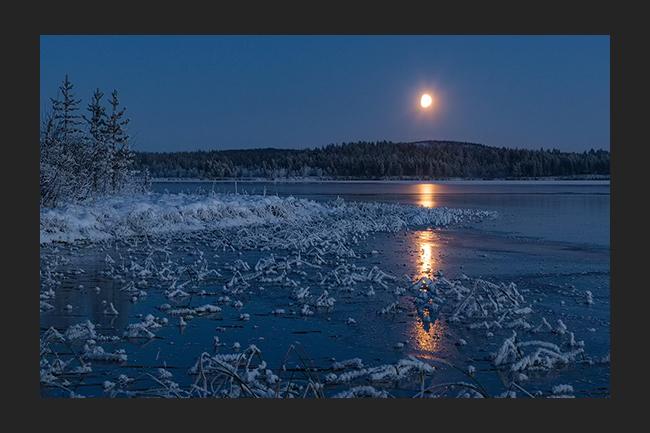 Moonrise above new ice