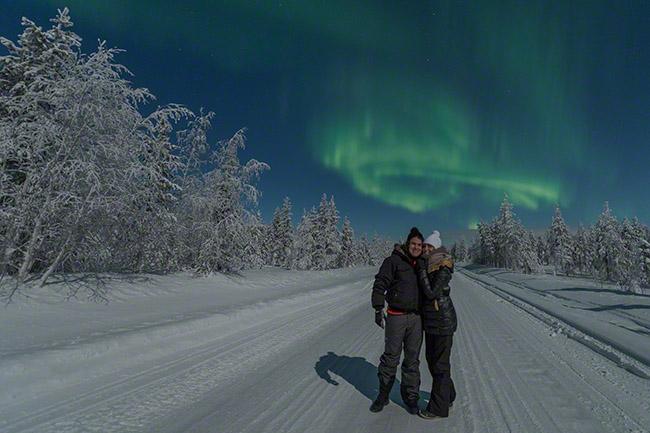 Very happy guests under the aurora