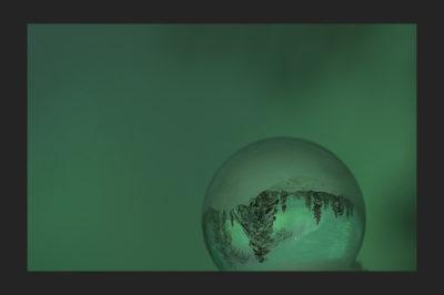 Auroras in a glass sphere