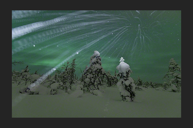 Snowfall with Northern lights