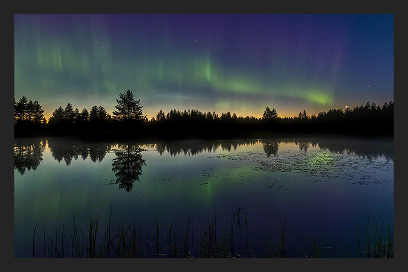 Northern lights above a lake