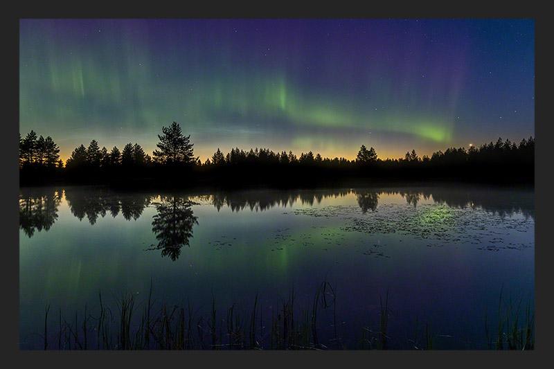 Northern lights above a lake